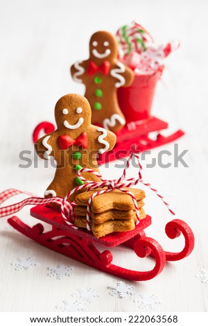 Gingerbread men cookies in a sledge - stock photo