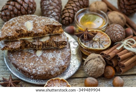 Gingerbread. Nuremberg gingerbread. Traditional Christmas and new year treats. Gingerbread with almonds, cinnamon, anise, coated with sugar glaze. Rustic style. Winter postcard. Selective focus - stock photo