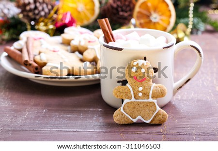 Gingerbread people biscuits with hot drink