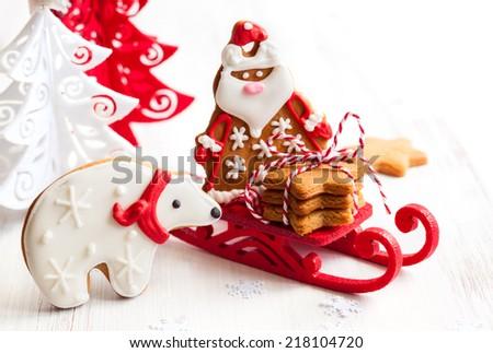 Gingerbread polar bear and Santa Claus - stock photo
