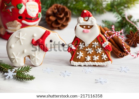 Gingerbread Santa Claus and polar bear with Christmas decor - stock photo