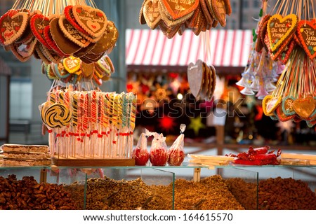 Gingerbreads, candies and nuts displayed on a Christmas market stall in Berlin, Germany - stock photo