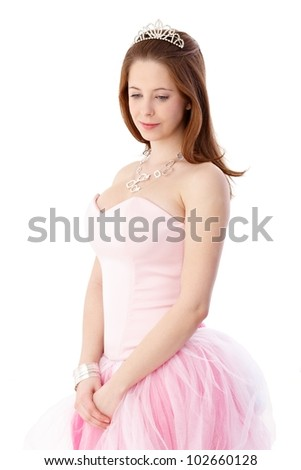 Gingerish girl in elegant coming out dress and headpiece. - stock photo