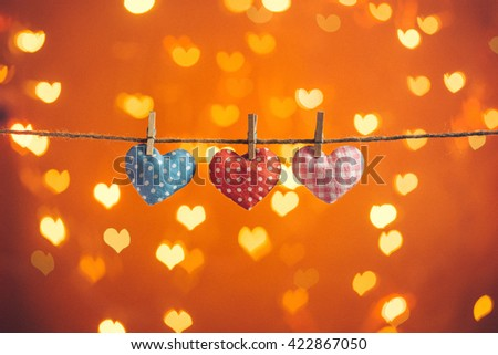 Gingham Love Valentine's hearts natural cord and wooden clips hanging on on the clothesline heart bokeh sparkle background, copy space - stock photo