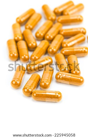 Ginseng herbal powder capsules isolated on white - stock photo