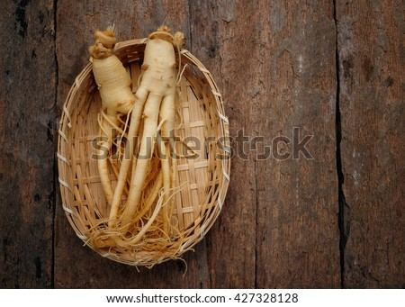 Ginseng on wood background,Korean ginseng on bamboo weave,with copy space. - stock photo