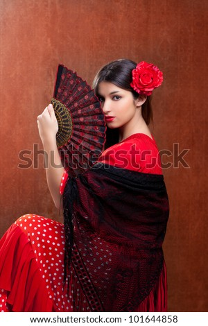 Gipsy flamenco dancer Spain girl with red rose and spanish hand fan - stock photo