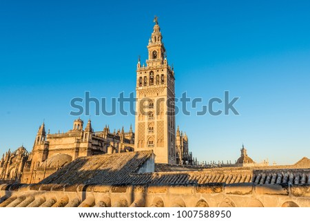 Giralda is the name given to the bell tower of the Cathedral of Santa Maria de la Sede of the city of Seville, in Andalusia, Spain. At its top is a ball called a jar on which stands the Giraldillo.