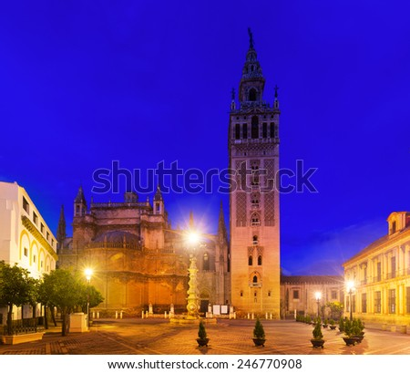 Giralda tower -  bell tower of the Seville Cathedral in evening. Seville, Spain - stock photo