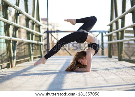 Girl acrobatics on the street. - stock photo