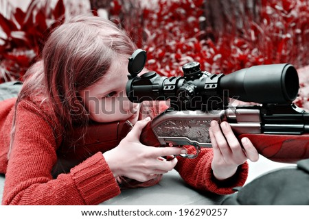 Girl aiming a pneumatic gun. Sport shooting