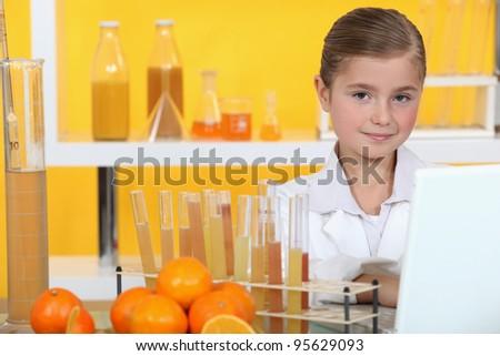 Girl analyzing juice - stock photo