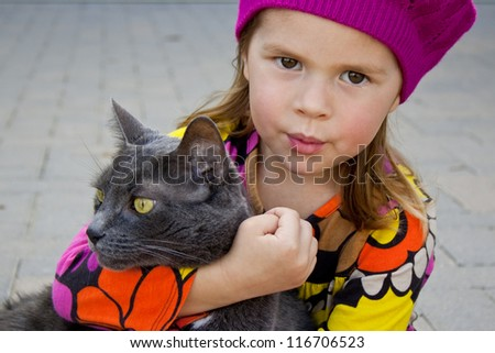 Girl and a gray cat