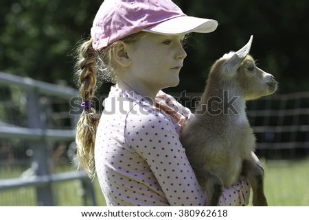 Girl and Baby Goat on the farm