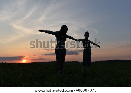 Girl and boy at sunset