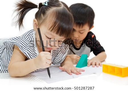 girl and boy busy with their drawing on the paper