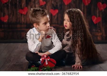 Girl and boy celebrating Valentines day.   - stock photo