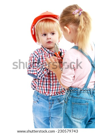 girl and boy considers pliers.Childhood education development in the Montessori school concept. Isolated on white background.