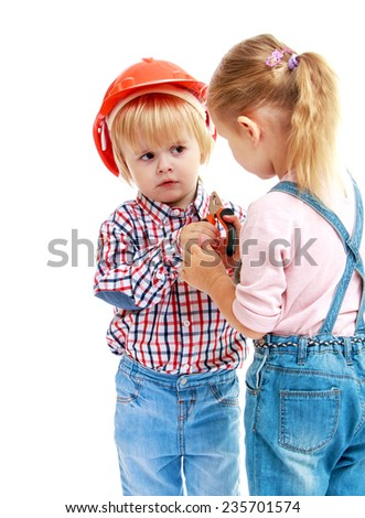 girl and boy considers pliers.Childhood education development in the Montessori school concept. Isolated on white background. - stock photo
