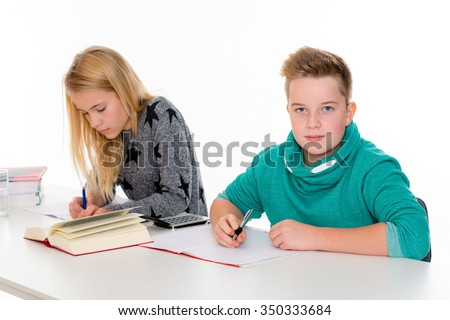girl and boy learning together in the classroom