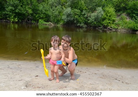 Girl and boy playing on the shore