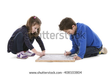 girl and boy playing with chalk board on white isolated background - stock photo
