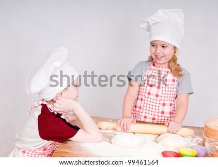 girl and boy say and prepare meal - stock photo