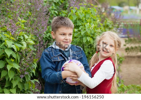 girl and boy with a ball - stock photo