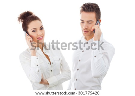 Girl and Boy With Phones Isolated On White Background - stock photo