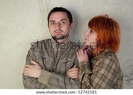 Girl and boy with the same jackets on a vintage background