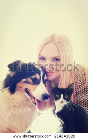 girl and dog and cat  - stock photo