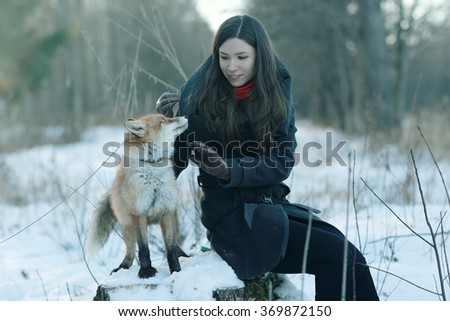 Girl and fox winter portrait