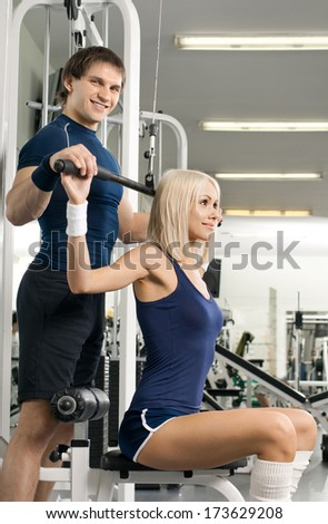 girl and guy,  execute exercise on sport-apparatus , in  sport-hall