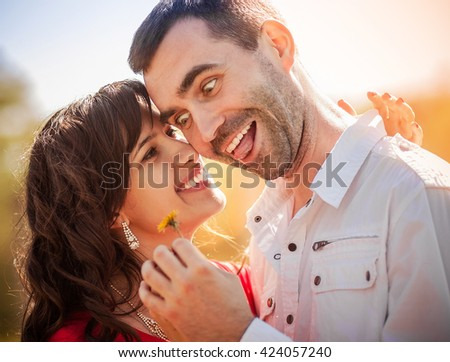 Girl and guy on the nature. Couple. - stock photo