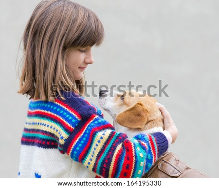 Girl and her dog communicating by eyes - stock photo