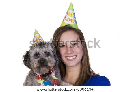 Girl and her dog in their birthday hats