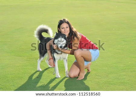 girl and her faithful husky - stock photo