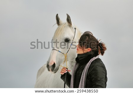 girl and her handsome horse - stock photo