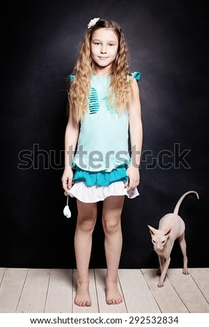 Girl and Kitten. Child with Cat. Two Friends - stock photo