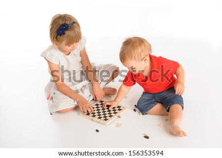 Girl and little boy playing chess isolated over white background