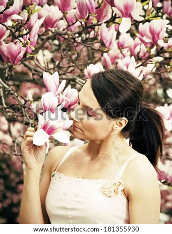 Girl and Magnolia flowers - spring time. - stock photo