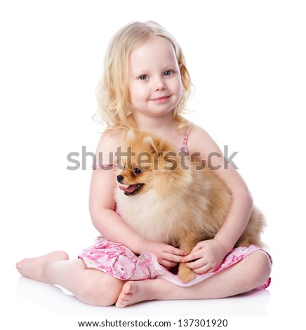 girl and puppy. looking at camera. isolated on white background - stock photo