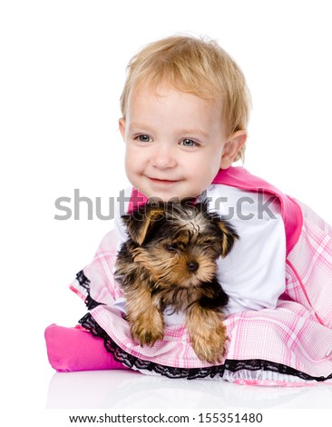 girl and puppy. looking at camera. isolated on white background