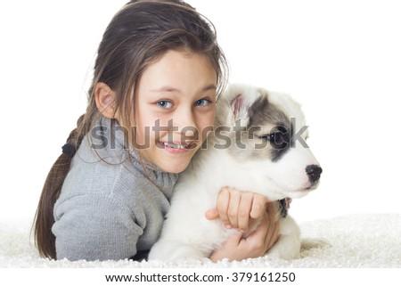 Girl and puppy Shepherd - stock photo