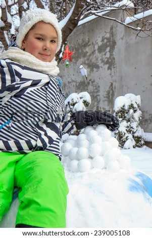 Girl and snowballs - stock photo