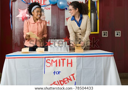 Girl and teacher counting votes - IS395-007 - stock photo