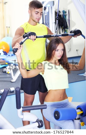 Girl and trainer in gym