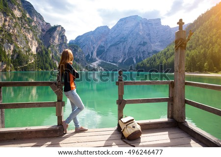 girl and view of well-known tyrolean lake lago di Braies Dolomites Italy