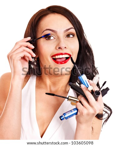 Girl applying makeup by brush. Isolated. - stock photo