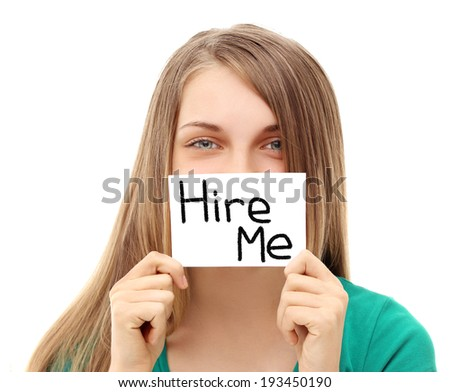 """Girl asking to get hired Sign saying """"Hire me"""" - stock photo"""